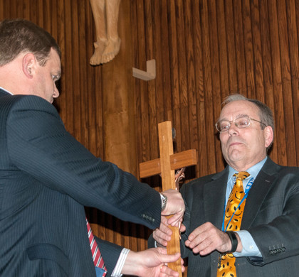 Phil Kiko passes the cross to the new lay director, Mike McBrady